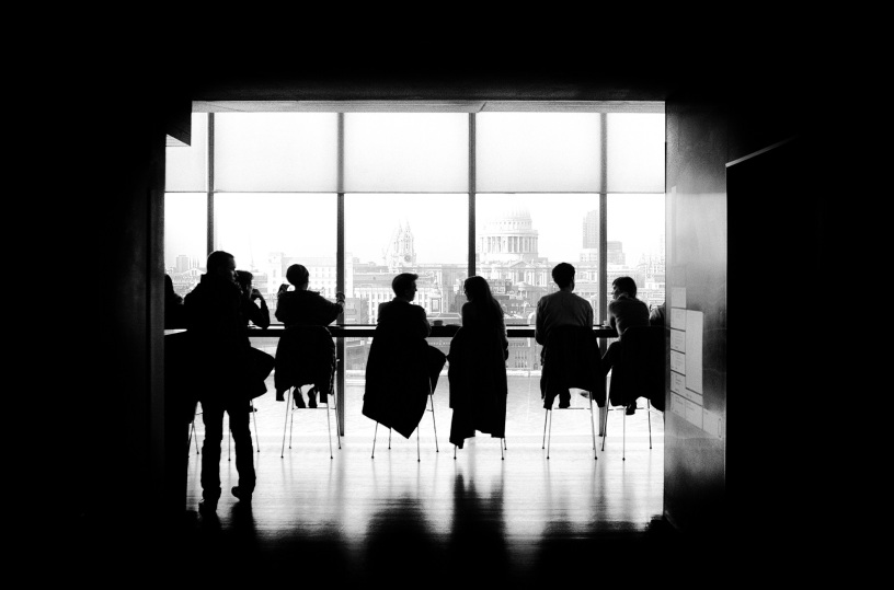 A group of people meeting at a table